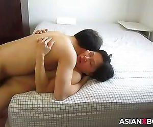 Asian MILF gets fucked good